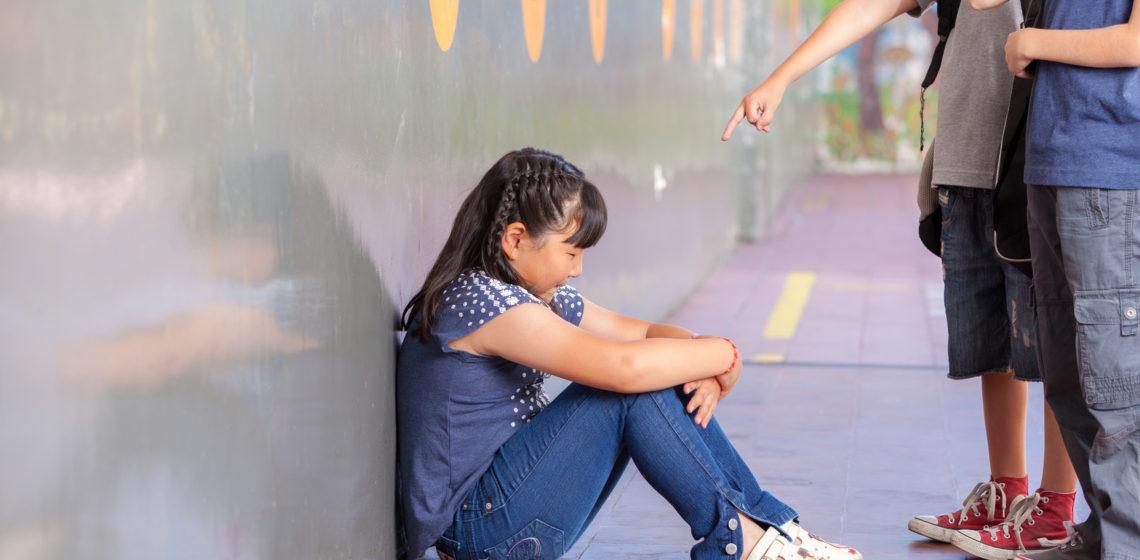 School bullying. Multiracial class.